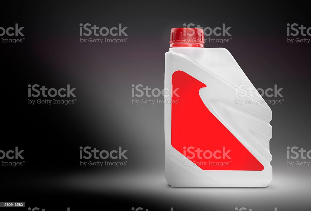 White plastic canister with blank red label stock photo