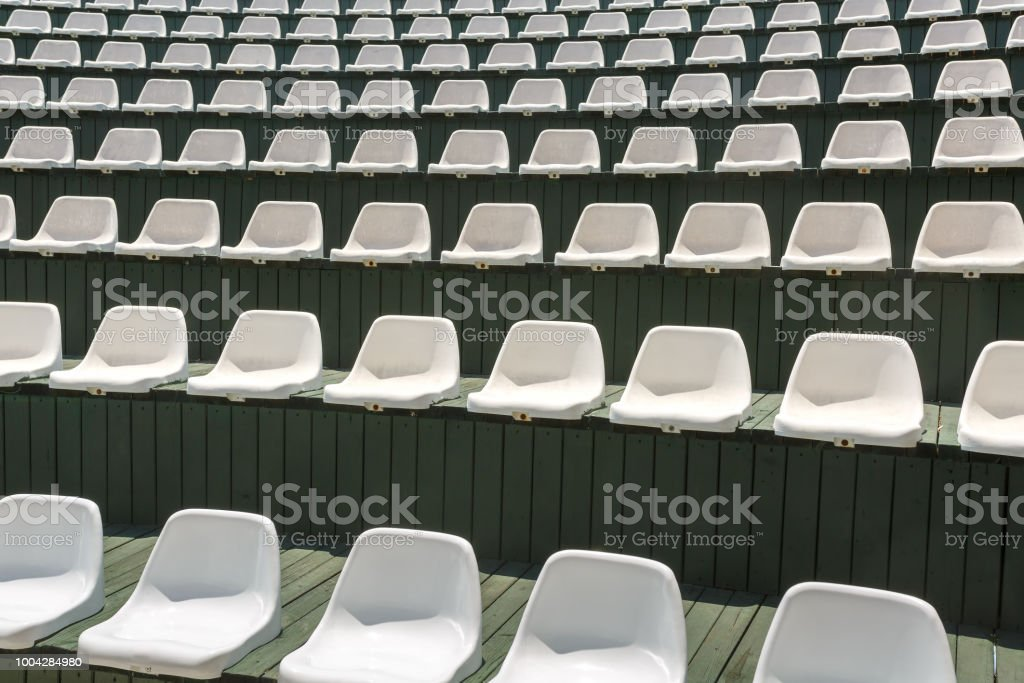White plastic chairs in outdoor theater or auditorium stock photo