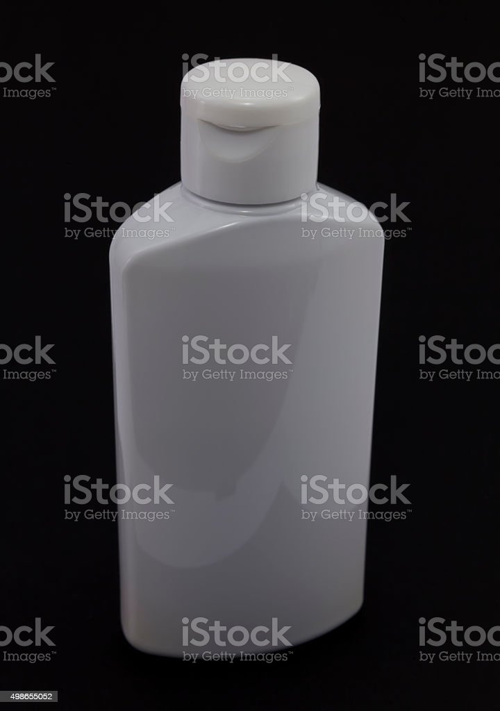 White plastic jar on a dark background. stock photo