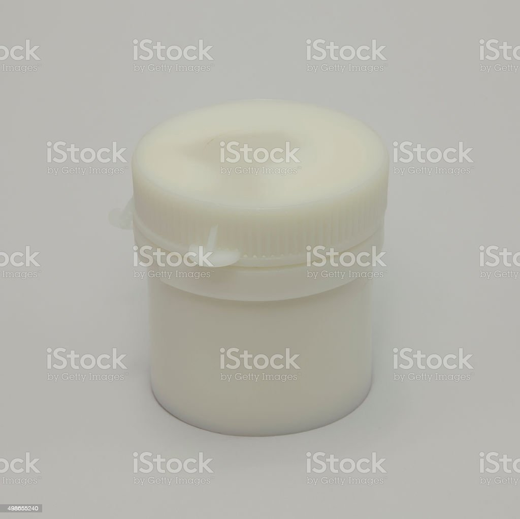 White plastic jar on a white background. stock photo