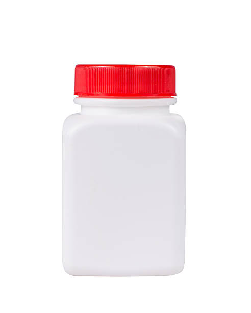 White plastic medical container with red cap on white background stok fotoğrafı