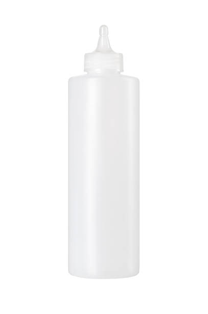 white plastic sauce bottle isolated over the white background - squeezing stock pictures, royalty-free photos & images