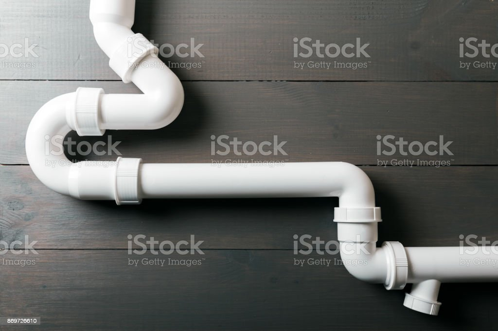 white plastic sewerage water pipes stock photo