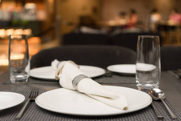white plate and clean glass on table - sport set competition round stock photos and pictures