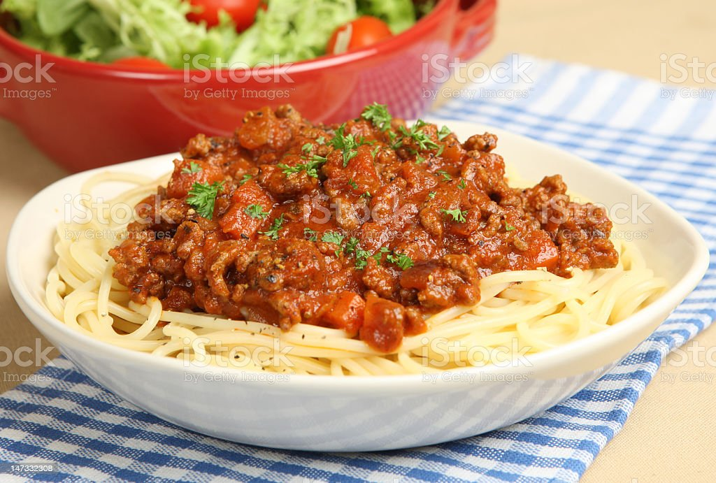 White plate full of spaghetti bolognaise stock photo