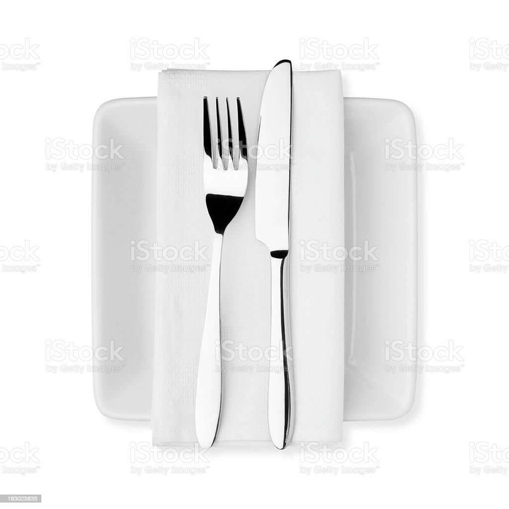 White plate, napkin, knife and fork on white background royalty-free stock photo