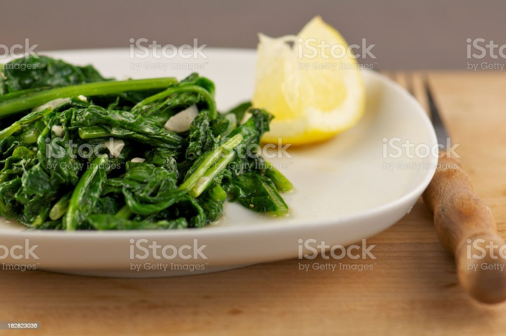 White Plate of Sauteed Leafy Greens stock photo