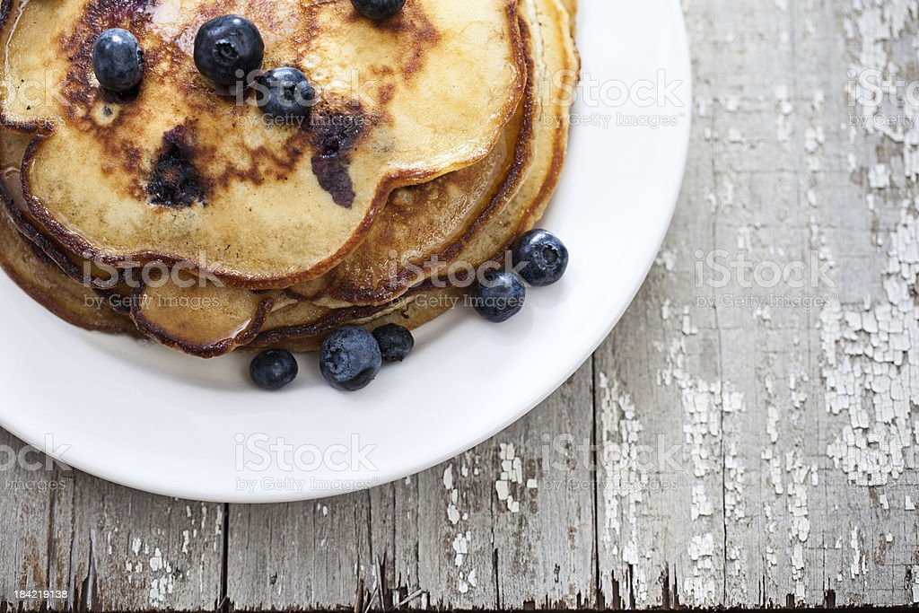 White plate with blueberry pancakes stock photo