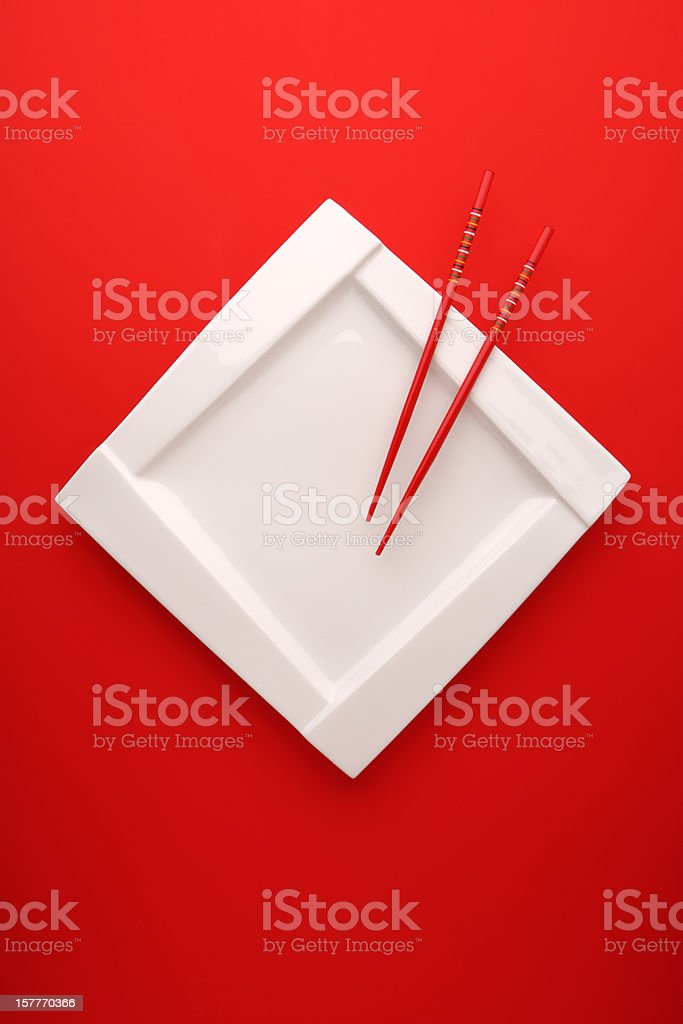 White plate with chopsticks stock photo