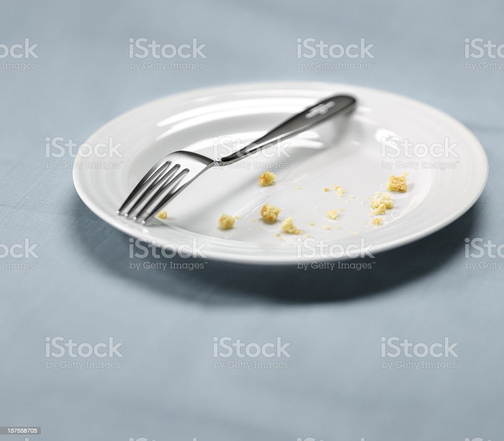White Plate with Crumbs, Satisfied meal royalty-free stock photo