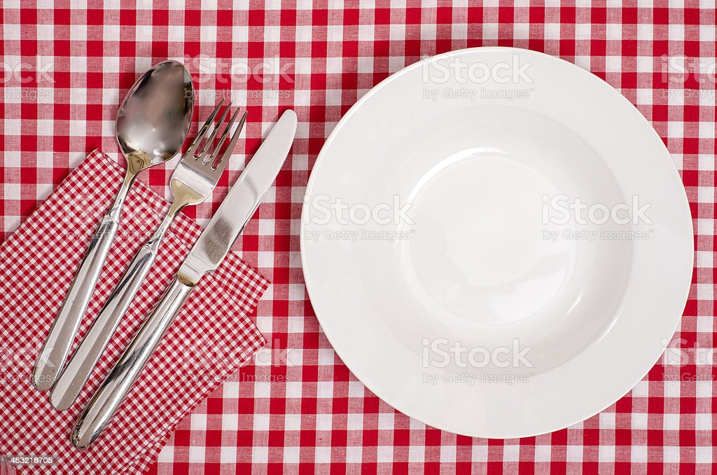 White plate with cutlery stock photo