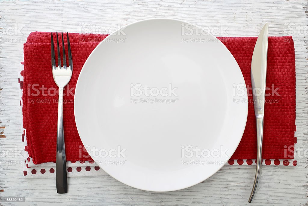 White plate with fork and knife stock photo