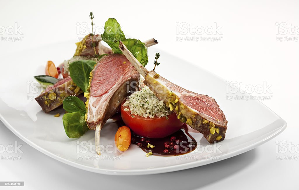 White plate with lamb chops and vegetables meal stock photo