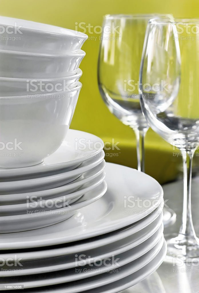 White Plates Bowls and Wine Glasses stock photo