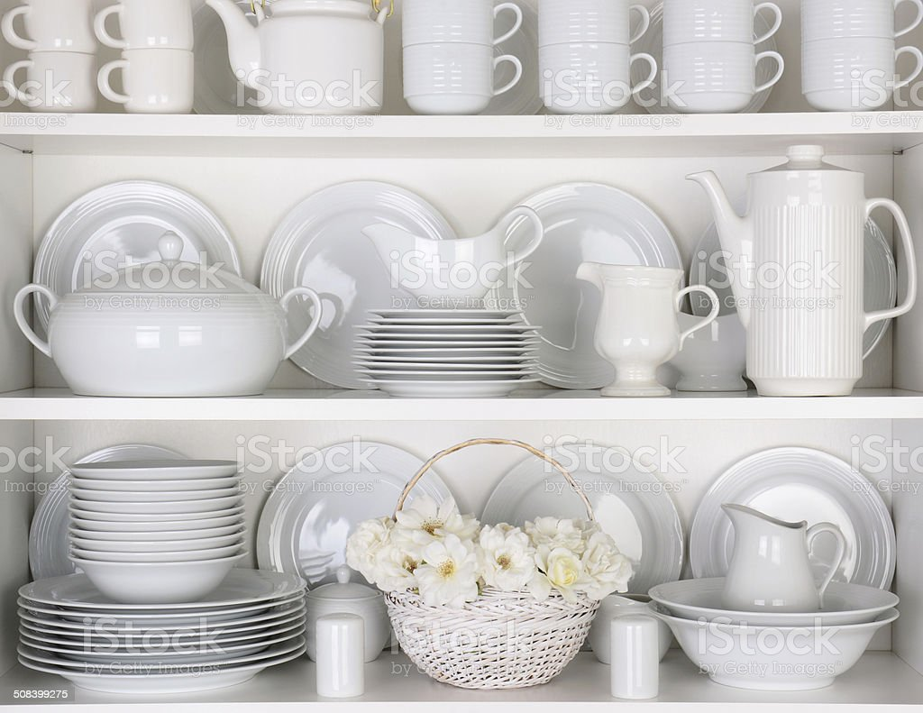 White Plates in Cupboard stock photo