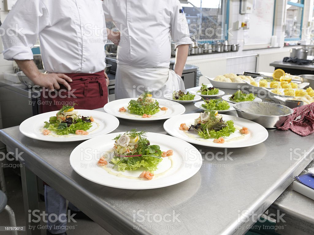 white plates with seafood salad ready to be served royalty-free stock photo