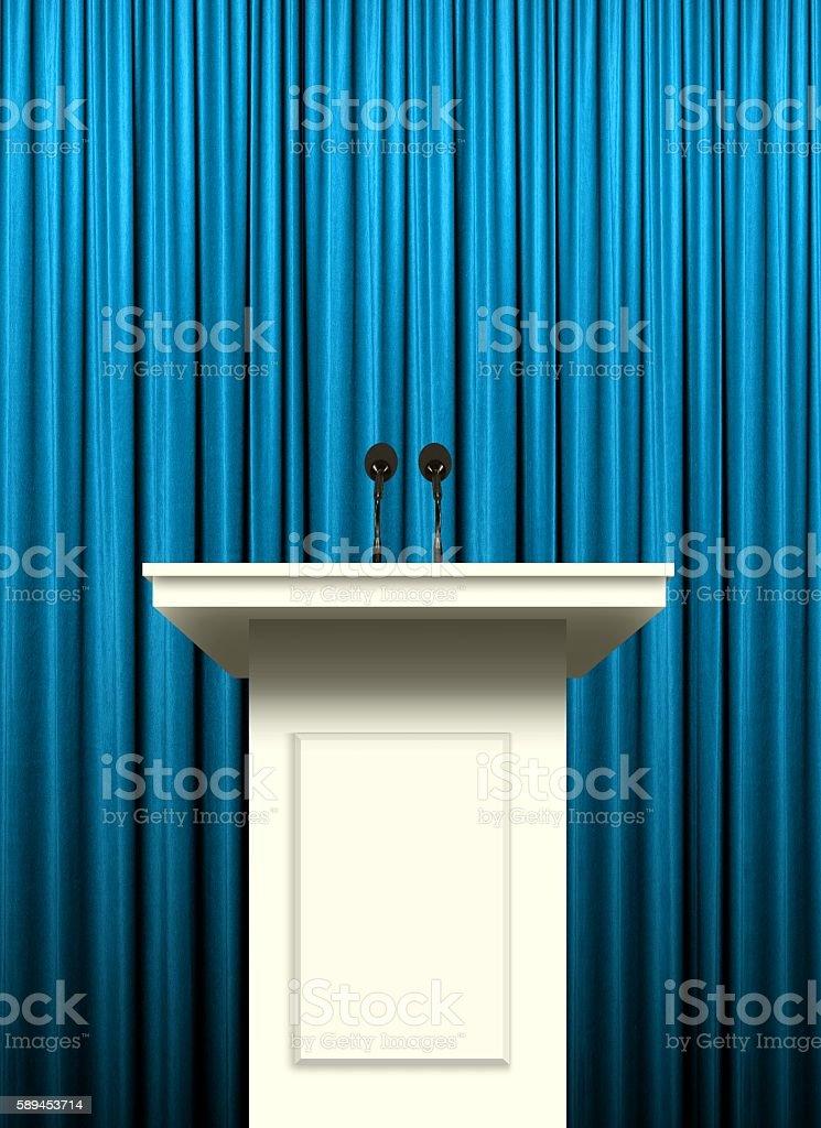 white podium over blue curtain background stock photo