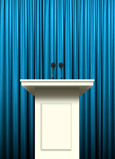 white podium over blue curtain background - debate стоковые фото и изображения