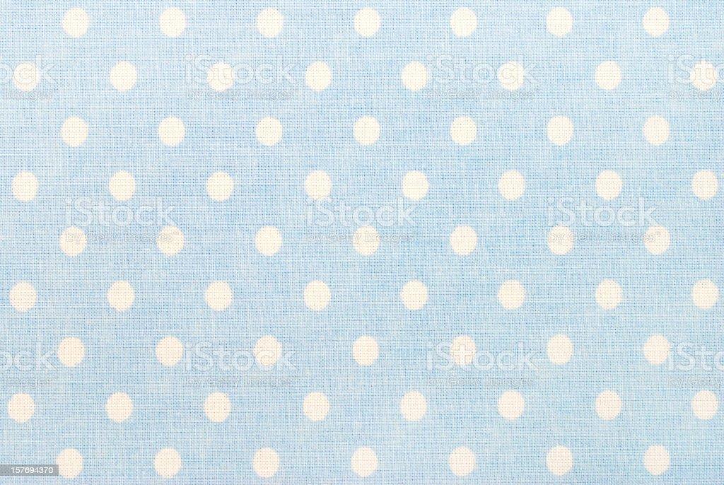 white polka dots on blue stock photo