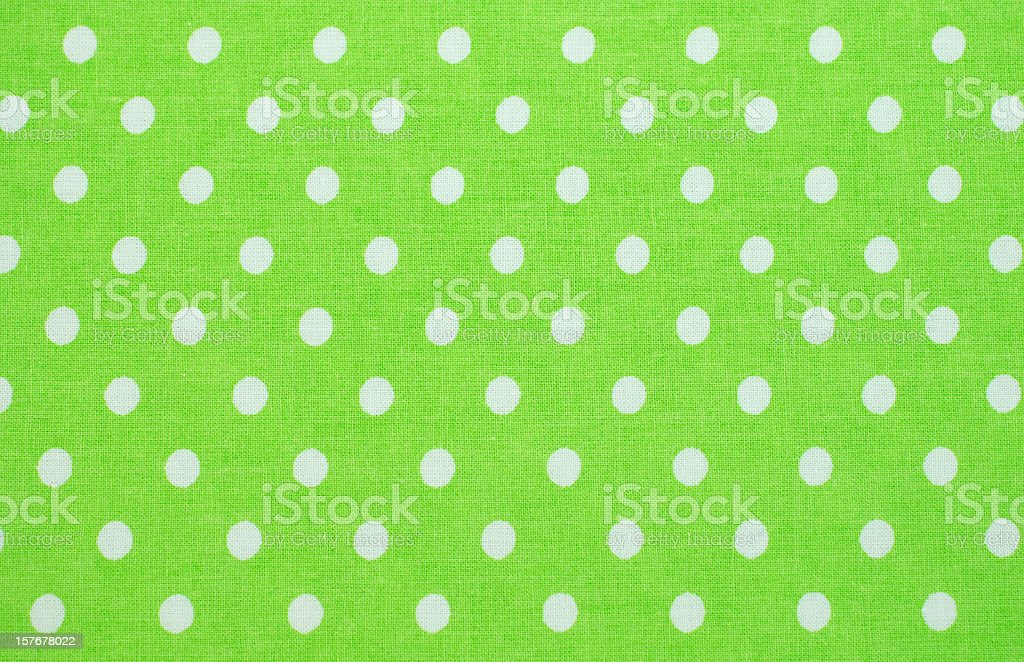 white polka dots on green royalty-free stock photo