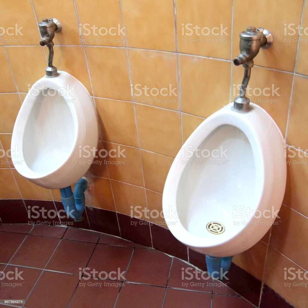 White Porcelain Urinals In Public Toilets Stock Photo - Download