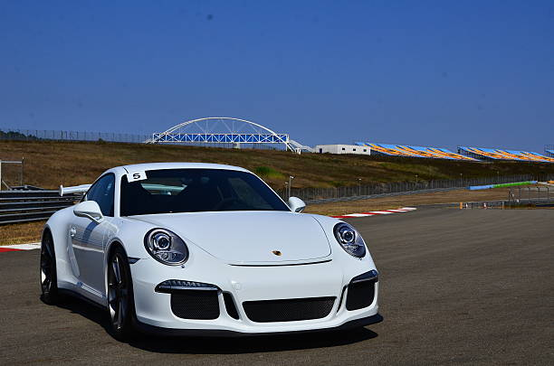 White Porcshe Istanbul, Turkey-July 30, 2015: Porsche GT3 parked on race track short-cut area.That has ready for track race. porsche stock pictures, royalty-free photos & images