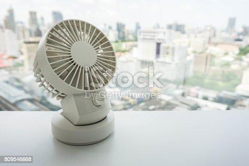 istock white portable USB desktop fan on office table 809546668