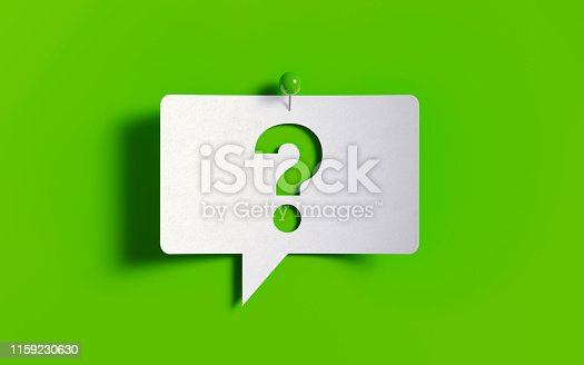 White post it note pinned with a green push pin on green background. There is a question mark symbol on the speech bubble. Horizontal composition with copy space.