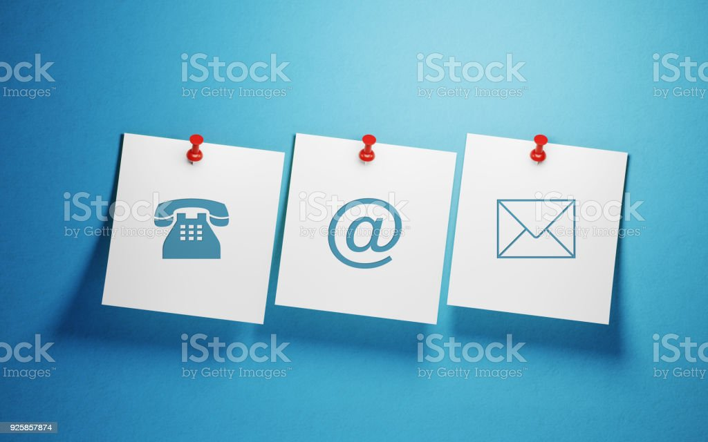 White Post It Notes Imprinted With Contact Us Symbols On Blue Background stock photo