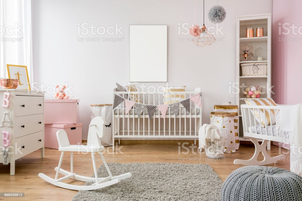 White poster mockup over crib stock photo