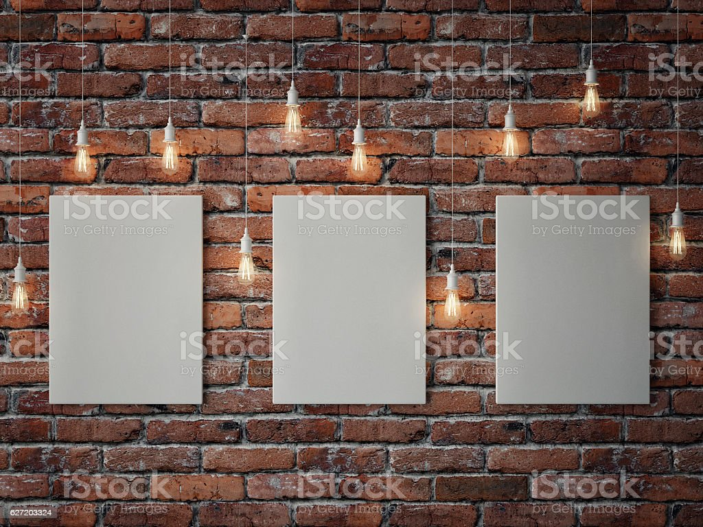 White posters with light bulbs on red brick wall - Photo