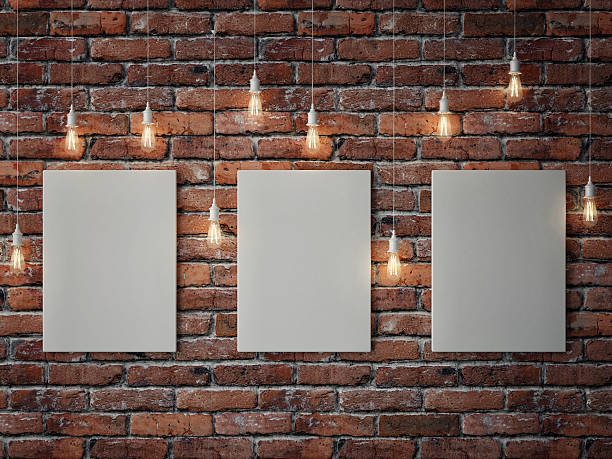 white posters with light bulbs on red brick wall - musikposter stock-fotos und bilder