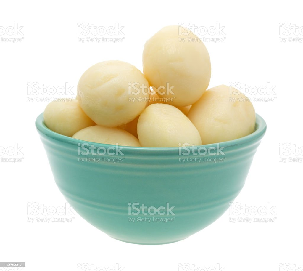 White potatoes in a bowl on white background stock photo