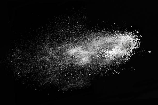 White powder explosion isolated on black stock photo