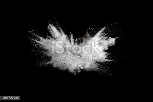 istock White powder explosion on black background.Stopping the movement of white powder on dark background. Launched white powder splash. 939727340