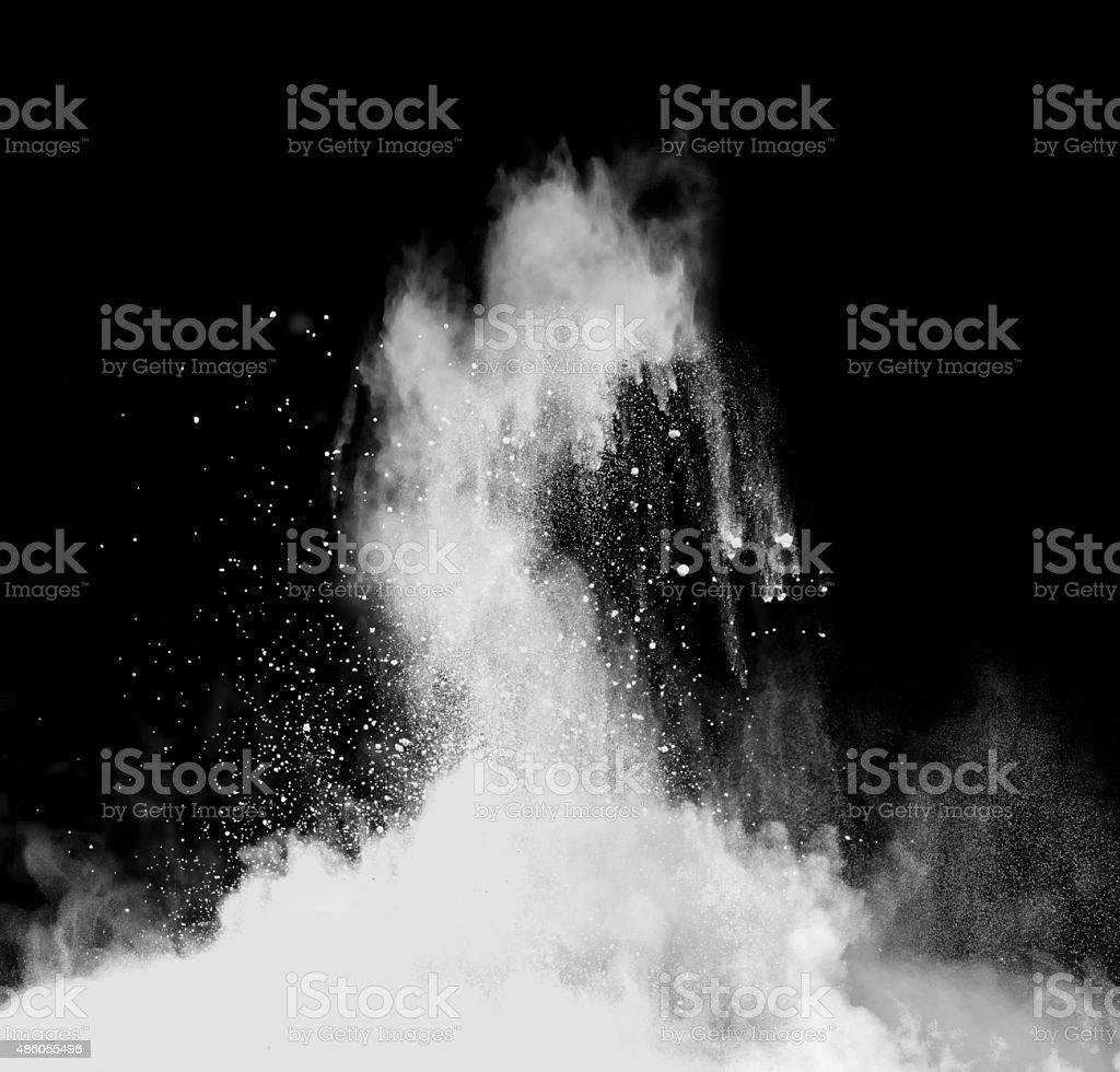 White powder on black background stock photo