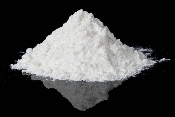 White powder on black reflective surface White powder on black reflective surface, closeup cocaine stock pictures, royalty-free photos & images