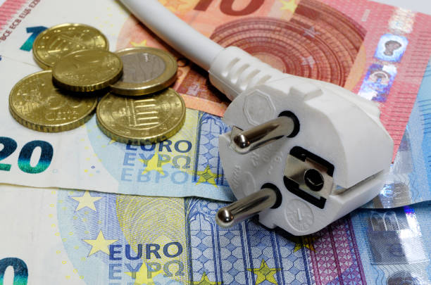 White power plug lying on euro banknotes stock photo