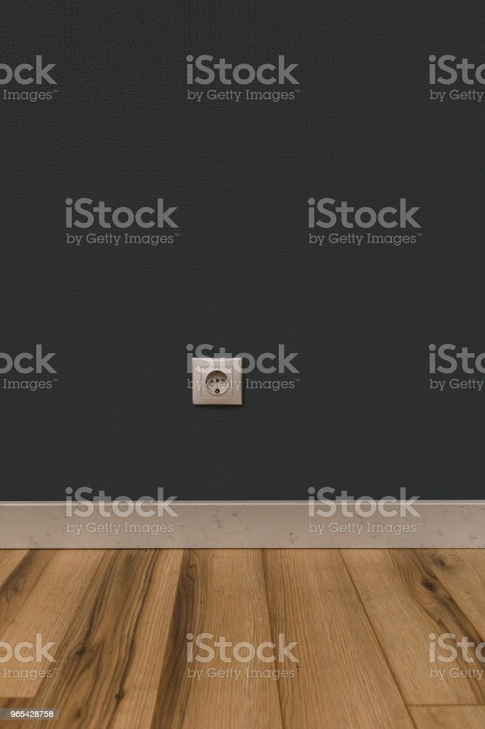 White power socket in wall over wooden floor zbiór zdjęć royalty-free