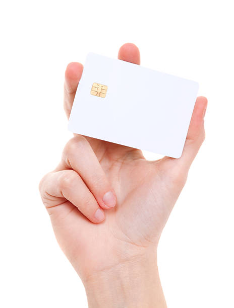 white prepaid card in woman's hand - gift voucher or card stock photos and pictures