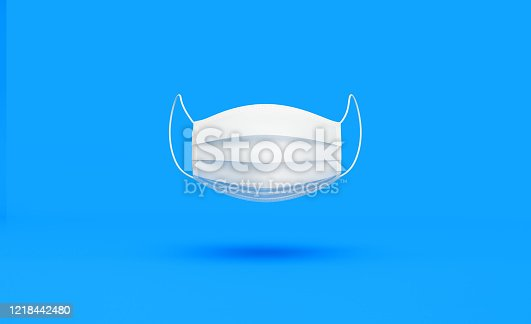 White protective mask over blue background, Horizontal composition. Health concept.