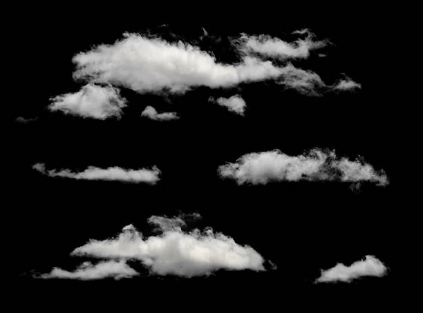 White puffy clouds in a black background White isolated clouds. Cutout extracted clouds clouds stock pictures, royalty-free photos & images