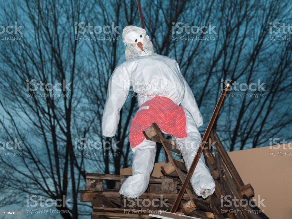 White Puppet Ready to be Burned in Wood Campfire stock photo