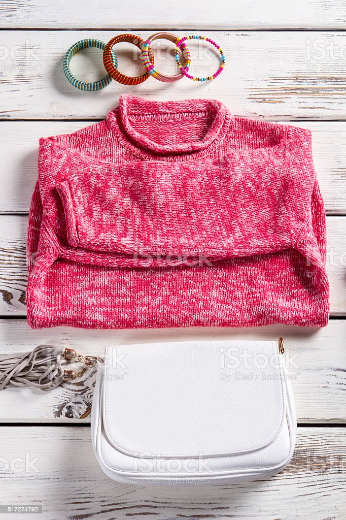 White purse and pink sweater. stock photo