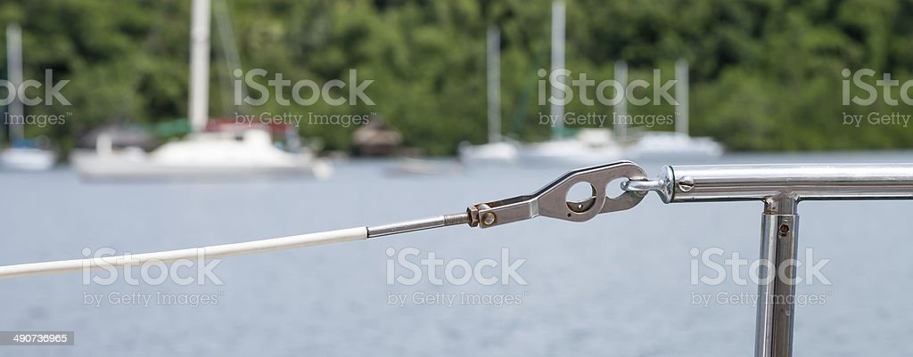 White PVC Coated Lineline, Gate and Stanchion on Sailboat stock photo