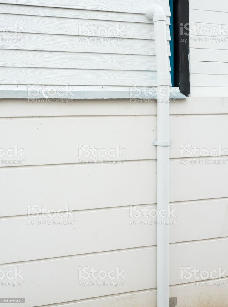 White PVC pipe with metal clip. stock photo
