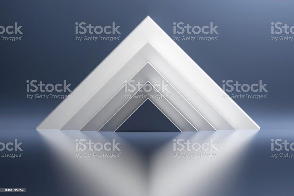 White pyramids on the blue background stock photo
