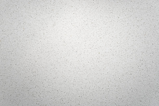 White quartz background countertop top view. White quartz background countertop. This light background is taken from a bright off-white quartz kitchen counter. The subtle texture can be used as surface or table backdrop graphic design element. table top view stock pictures, royalty-free photos & images