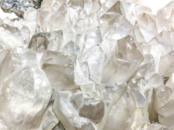 White Quartz Crystal cluster on black background. White Quartz Crystal cluster on black background. It's selective focus. quartz stock pictures, royalty-free photos & images