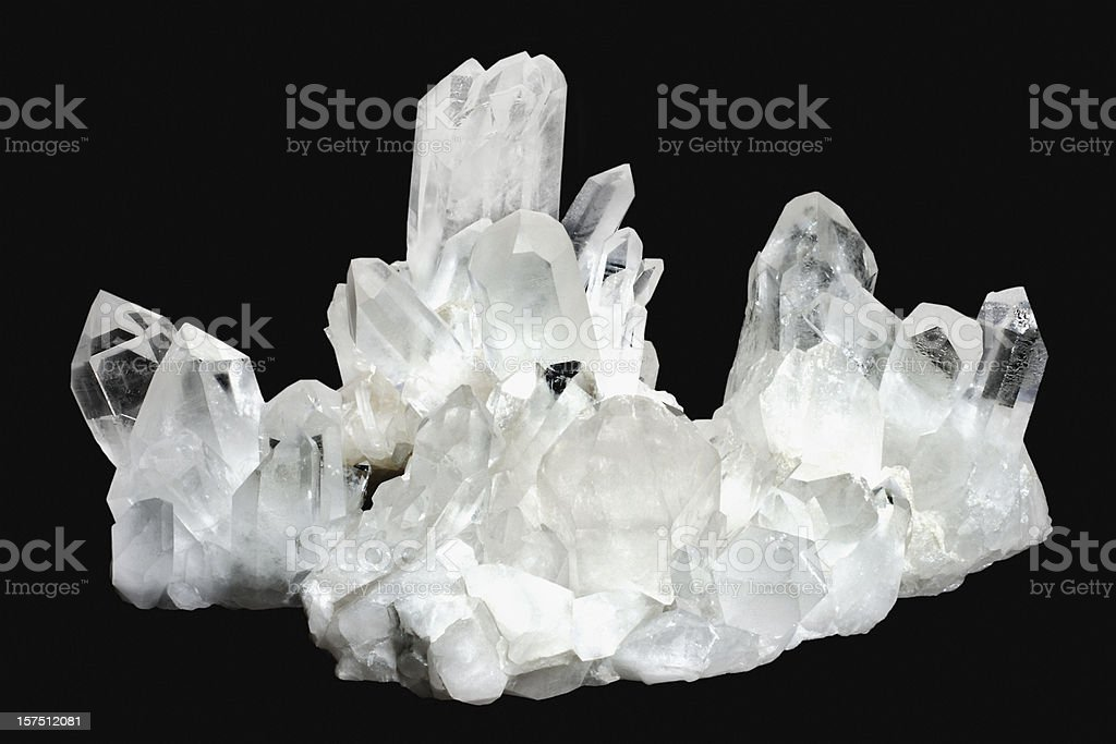 White quartz crystals on a black background  stock photo